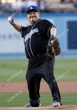 Actor Wayne Knight throws the ceremonial first pitch before a baseball game between the Los Angeles Dodgers and the New York Mets, in Los Angeles