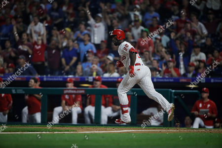 Philadelphia Phillies' Andrew McCutchen runs the basses after hitting a home run with one run batted in off of St. Louis Cardinals pitcher Michael Wacha during the fifth inning of a baseball game, in Philadelphia