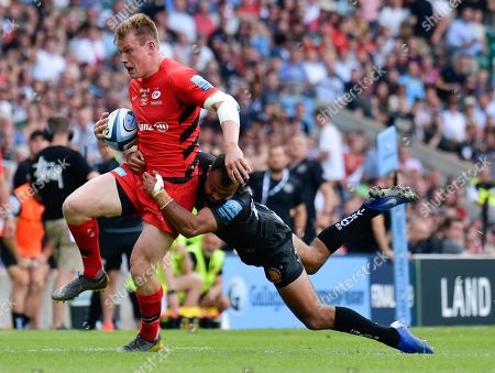 Tom O'Flaherty of Exeter Chiefs makes a tackle on Marcelo Bosch of Saracens