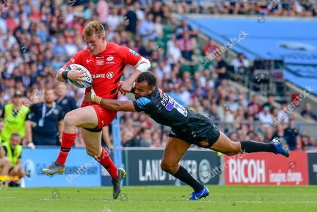 Stock Image of Tom O'Flaherty of Exeter Chiefs makes a tackle on Marcelo Bosch of Saracens