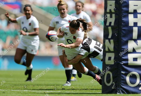Danielle Waterman of Barbarians Women knocks the ball out of Leanne Riley of England Women hands to save the try
