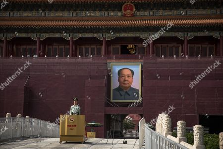 A member of China's People's Liberation Army (PLA) stands guard in front of the Chairman Mao portrait on the south gate of the Forbidden City, next to the Tiananmen Square, in Beijing, China, 16 May 2019 (issued 30 May 2019). This year, 04 June 2019 marks the 30th anniversary of the 1989 Tiananmen Square protests. Between 15 April and 04 June 1989, students, intellectuals, and activists engaged in a series of demonstrations against the Chinese Communist Party where the subsequent crackdown by authorities caused a vast number of civilians' deaths and injuries. The Tiananmen Square protests remains one of the most sensitive and most widely censored topics in China.