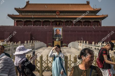 Chinese tourists pose for photos in front of the Chairman Mao portrait on the south gate of the Forbidden City, next to the Tiananmen Square, in Beijing, China, 16 May 2019 (issued 30 May 2019). This year, 04 June 2019 marks the 30th anniversary of the 1989 Tiananmen Square protests. Between 15 April and 04 June 1989, students, intellectuals, and activists engaged in a series of demonstrations against the Chinese Communist Party where the subsequent crackdown by authorities caused a vast number of civilians' deaths and injuries. The Tiananmen Square protests remains one of the most sensitive and most widely censored topics in China.
