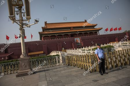 A Chinese policeman stands guard aside from a lamp post holding surveillance cameras, and in front of the Chairman Mao portrait on the south gate of the Forbidden City, next to the Tiananmen Square, in Beijing, China, 16 May 2019 (issued 30 May 2019). This year, 04 June 2019 marks the 30th anniversary of the 1989 Tiananmen Square protests. Between 15 April and 04 June 1989, students, intellectuals, and activists engaged in a series of demonstrations against the Chinese Communist Party where the subsequent crackdown by authorities caused a vast number of civilians' deaths and injuries. The Tiananmen Square protests remains one of the most sensitive and most widely censored topics in China.