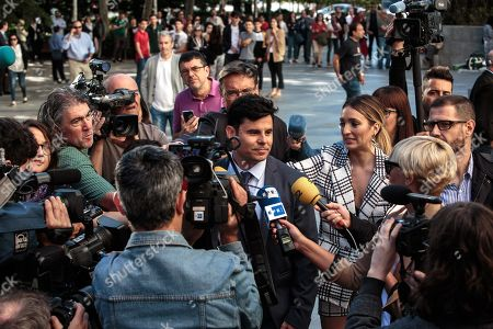 Plaintiff and alleged Spanish singer Julio Iglesias' son Spaniard Javier Sanchez-Santos (C) talks to the media upon his arrival at court for the paternity suit trial hearing against the singer in Valencia, eastern Spain, 30 May 2019. The trial will run behind closed doors and Iglesias will not attend the hearing. Sanchez-Santos has a DNA test, obtained by a private detective in Miami, from an object put in the bin by Julio Jose Iglesias, Julio Iglesias' son, in a beach.