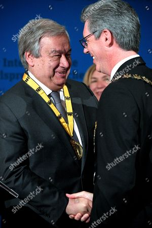 United Nations (UN) Secretary-General Antonio Guterres (L) shakes hands with Mayor of Aachen Marcel Philipp (R) during the Charlemagne Prize (Karlspreis) ceremony at the town hall in Aachen, Germany, 30 May 2019. The International Charlemagne Prize of the German City of Aachen is awarded annually since 1950 to people who have contributed to the ideals upon which Europe has been founded. United Nations (UN) Secretary-General Guterres is this year's designated Karlspreis winner.