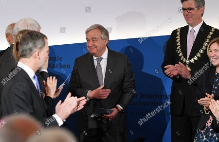 Stock Image of United Nations (UN) Secretary-General Antonio Guterres (C) receives the Charlemagne medal from the Mayor of Aachen Marcel Philipp (R) during the Charlemagne Prize (Karlspreis) ceremony at the town hall in Aachen, Germany, 30 May 2019. The International Charlemagne Prize of the German City of Aachen is awarded annually since 1950 to people who have contributed to the ideals upon which Europe has been founded.