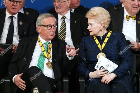 Lithuanian President Dalia Grybauskaite (R) and European Commission President Jean-Claude Juncker attend the Charlemagne Prize (Karlspreis) ceremony at the town hall in Aachen, Germany, 30 May 2019. The International Charlemagne Prize of the German City of Aachen is awarded annually since 1950 to people who have contributed to the ideals upon which Europe has been founded.