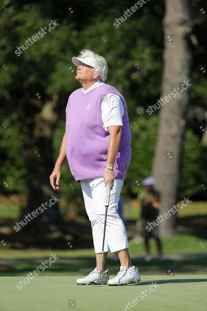 Laura Davies of England, reacts to a putt on the 12th green during the first round of the U.S. Women's Open golf tournament, in Charleston, S.C