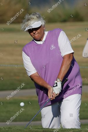 Laura Davies of England, chips up to the 16th green during the first round of the U.S. Women's Open golf tournament, in Charleston, S.C