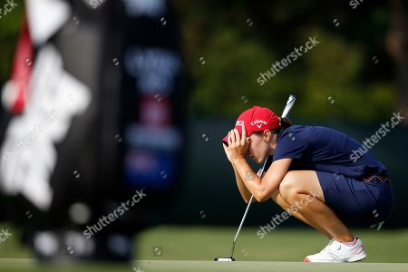 Stock Photo of Jane Park lines up a putt on the fourth green during the first round of the U.S. Women's Open golf tournament, in Charleston, S.C