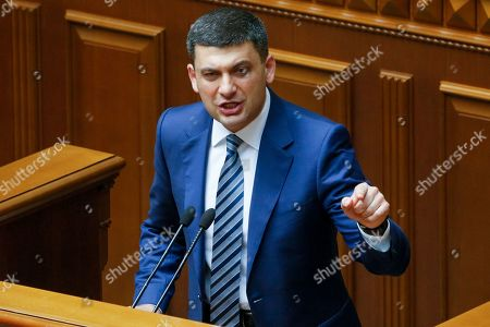Ukrainian Prime Minister Volodymyr Groysman gestures as he addresses the Ukrainian parliament in Kiev, Ukraine,. Ukrainian lawmakers refused to accept the Cabinet's resignation in a snub to the nation's newly-sworn president, Volodymyr Zelensky, who wants to form his own team but faces parliament dominated by supporters of his election rival