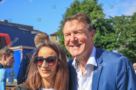 Phil Tufnell poses for photographs with a fan