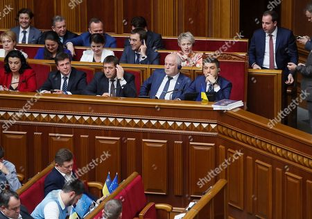 Stock Image of Ukrainian Prime Minister Volodymyr Groysman (2-R, seated) and members of cabinet attend a Parliament session in Kiev, Ukraine, 30 May 2019, as deputies discuss his resignation. The Ukrainian parliament voted to reject Prime Minister Groysman's resignation arguing that his stepping down would lead to chaos before the country's snap elections expected in 21 July 2019. Groysman presented his resignation following President Volodymyr Zelenskiy's inauguration on 20 May 2019.
