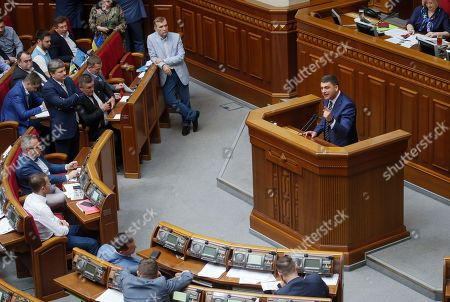 Ukrainian Prime Minister Volodymyr Groysman (R) speaks to lawmakers during a Parliament session in Kiev, Ukraine, 30 May 2019, as deputies discuss his resignation. The Ukrainian parliament voted to reject Prime Minister Groysman's resignation arguing that his stepping down would lead to chaos before the country's snap elections expected in 21 July 2019. Groysman presented his resignation following President Volodymyr Zelenskiy's inauguration on 20 May 2019.
