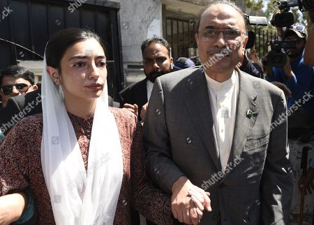 Stock Image of Asif Zardari, former President and chairman of opposition party Pakistan Peoples Party holds hands of his daughter Asifa Bhutto Zardari as he appears before the Islamabad High Court to get his interim bail extended in Islamabad, Pakistan, 30 May 2019. Islamabad High Court extended the pre-arrest bail of former president and Pakistan Peoples Party (PPP) co-chairperson Asif Ali Zardari and his sister Faryal Talpur till June 10 in the fake bank accounts case.
