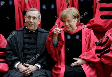Lawrence Bacow, Angela Merkel, Huda Zoghbi, James Earl Jones, Mark Zuckerberg. Harvard President Lawrence Bacow, left, and German Chancellor Angela Merkel speak while sitting for a photograph before joining a procession though Harvard Yard at the start of Harvard University commencement exercises, in Cambridge, Mass