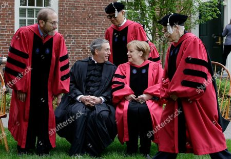 Lawrence Bacow, Angela Merkel, Huda Zoghbi, James Earl Jones, Mark Zuckerberg. Harvard President Lawrence Bacow, center left, and German Chancellor Angela Merkel, center right, speak while others take their seats for a photograph before joining a procession though Harvard Yard at the start of Harvard University commencement exercises, on the schools campus, in Cambridge, Mass