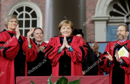 Drew Faust, Angela Merkel, Alan Garber, Huda Zoghbi, James Earl Jones, Mark Zuckerberg. German Chancellor Angela Merkel, center, places her hands together as she receives applause while being presented with an honorary Doctor of Laws degree as former Harvard President Drew Faust, left, and Harvard Provost Alan Garber, right, look on during Harvard University commencement exercises, on the schools campus, in Cambridge, Mass