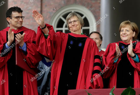 David Remnick, Drew Faust, Angela Merkel, Huda Zoghbi, James Earl Jones, Mark Zuckerberg. Former Harvard President Drew Faust, center, waves to the audience as author and editor of The New Yorker magazine David Remnick, left, and German Chancellor Angela Merkel, right, applaud during Harvard University commencement exercises, on the school's campus, in Cambridge, Mass. Faust was presented with an honorary Doctor of Laws degree during the ceremonies
