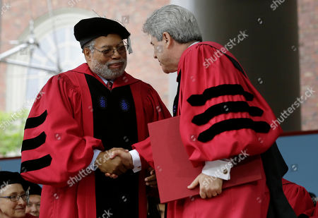Lonnie Bunch III, Marc Goodheart. Historian Lonnie Bunch III, left, is presented with an honorary Doctor of Laws degree by Vice President and Secretary of Harvard University Marc Goodheart, right, during Harvard University commencement exercises, on the school campus, in Cambridge, Mass