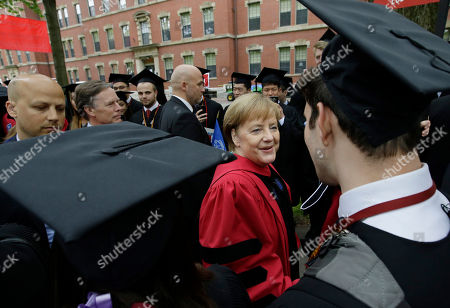 Huda Zoghbi,James Earl Jones,Mark Zuckerberg. German Chancellor Angela Merkel greets graduating Harvard students as she walks in a procession though Harvard Yard at the start of Harvard University commencement exercises, in Cambridge, Mass