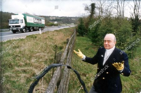 Mohamed Al Fayed Harrods Chairman Mohamed Al Fayed Is Suing The Department Of Transport Over Claims That 'stinking' Pollution From The M25 Motorway Is Spoiling His Nearby Country Estate. In A High Court Writ Mohamed Al Fayed Alleges That Water Seeping On To His Land From Parts Of The Motorway Contains Chemicals Which Have A Detrimental Effect On His Animals. Mohamed Al Fayed Says Lead Petroleum Hydrocarbons Oil Grease And Cadmium Have Spread Through The Watercourses To Settle In The Soil Of Barrow Green Court Oxted Surrey.... Businessman