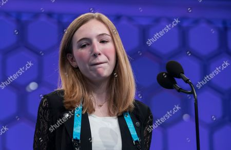 Stock Picture of Phoebe Smith of Morton, Pennsylvania, reacts after incorrectly spelling 'pelargic' during the final round of the 2019 Scripps National Spelling Bee at National Harbor in Oxon Hill, Maryland, USA, 30 May 2019. The 92nd year of the Scripps National Spelling Bee began with 562 competitors and includes a 50,000 US dollar prize for the champion speller.