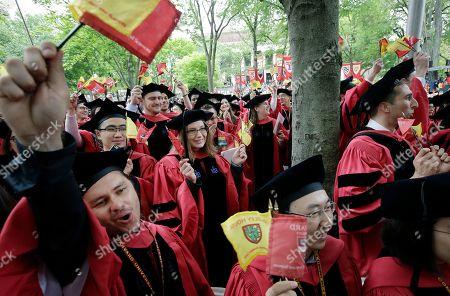 Huda Zoghbi, James Earl Jones, Mark Zuckerberg. Harvard University students graduating with masters degrees in philosophy celebrate during Harvard University's commencement exercises, on the schools campus in Cambridge, Mass
