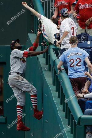 St. Louis Cardinals right fielder Dexter Fowler catches a foul ball hit by Philadelphia Phillies' Andrew McCutchen for the final out of the ninth inning of a baseball game, in Philadelphia. St. Louis won 5-3