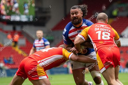 David Fifita (8) of Wakefield Trinity is tackled by Julian Bousquet (14) of Catalans Dragons