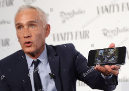 Mexican journalist Jorge Ramos shows an interview between him and Venezuelan President Nicolas Maduro on his phone, that was seized by Venezuelan authorities and then given back to him, during the event in which he was awarded the International Journalist Award 2019 Vanity Fair in Madrid, Spain.