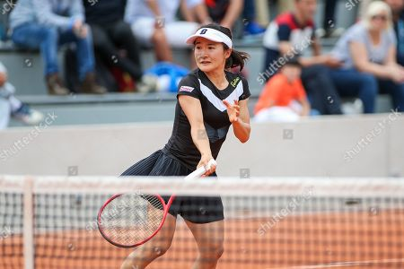 Stock Image of Shuko Aoyama of Japan during the Mixed doubles first round match of the French Open tennis tournament against Lyudmyla Kichenok of Ukraine and Santiago Gonzalez of Mexico
