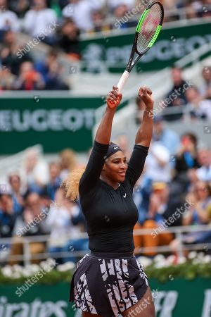 Stock Photo of Serena Williams of the United States celebrates as she wins the women's singles second round match of the French Open tennis tournament against Kurumi Nara of Japan