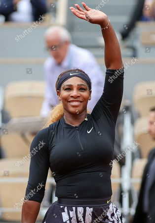 Serena Williams of the United States celebrates as she wins the women's singles second round match of the French Open tennis tournament against Kurumi Nara of Japan