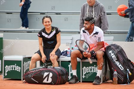Shuko Aoyama of Japan and Divij Sharan of India after the Mixed doubles first round match of the French Open tennis tournament against Lyudmyla Kichenok of Ukraine and Santiago Gonzalez of Mexico
