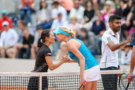 Shuko Aoyama of Japan and Divij Sharan of India greet Lyudmyla Kichenok of Ukraine and Santiago Gonzalez of Mexico after the Mixed doubles first round match of the French Open tennis tournament