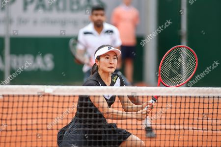 Stock Picture of Shuko Aoyama of Japan during the Mixed doubles first round match of the French Open tennis tournament against Lyudmyla Kichenok of Ukraine and Santiago Gonzalez of Mexico