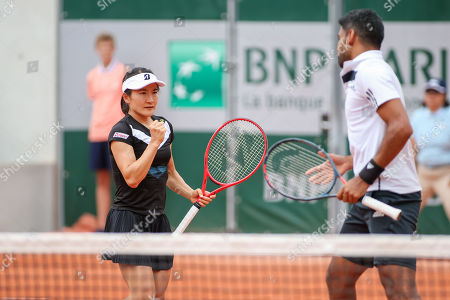 Shuko Aoyama of Japan and Divij Sharan of India during the Mixed doubles first round match of the French Open tennis tournament against Lyudmyla Kichenok of Ukraine and Santiago Gonzalez of Mexico
