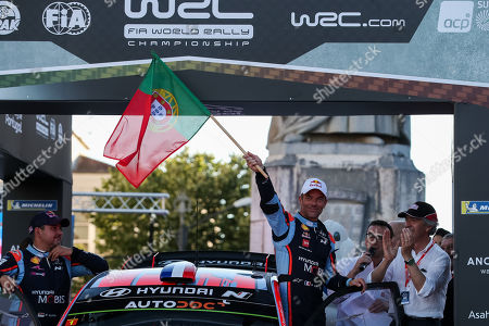 Sebastien Loeb of France waves a flag of Portugal on top of his Hyundai i20 Coupe WRC during the ceremonial start on the first day of the Rally de Portugal as part of the World Rally Championship (WRC) in Coimbra, centre of Portugal, 30 May 2019.