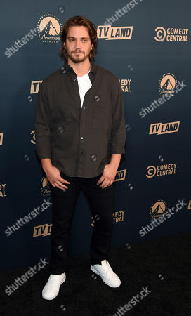 """Luke Grimes, a cast member in the Paramount Network television series """"Yellowstone,"""" poses at the Paramount Network, Comedy Central, TV Land Press Day 2019 at the London West Hollywood, in West Hollywood, Calif"""