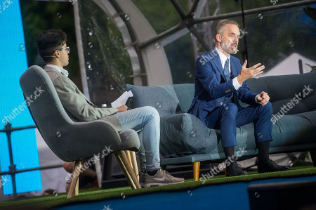 Canadian psychologist Jordan Peterson (R) speaks on a stage in front of St. Stephen Basilica during Brain Bar Future Festival in Budapest, Hungary, 30 May 2019. At left host Matyas Kohan is seated.