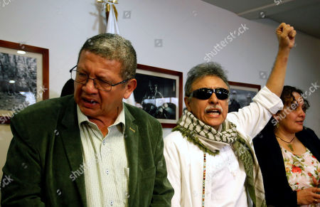 Leader of FARC political party Seuxis Paucias Hernandez (C), also known as 'Jesus Santrich', attends a press conference after being released by Colombian Prosecutor's Office accompanied by his comrade Jorge Torres Victoria (L), alias 'Pablo Catatumbo', in Bogota, Colombia, 30 May 2019. The Colombian Prosecutor's Office released Jesus Santrich in compliance with an order of the Supreme Court of Justice because he enjoys jurisdiction for having been appointed congressman.