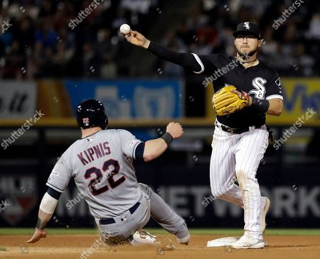 Yolmer Sanchez, Jason Kipnis. Chicago White Sox second baseman Yolmer Sanchez, right, throws out Cleveland Indians' Roberto Perez at first after forcing out Jason Kipnis at second during the sixth inning of a baseball game in Chicago
