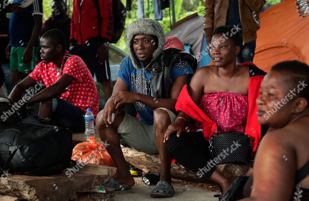"""A group of migrants from Cameroon rest in Bajo Chiquito, Darien province, Panama. Simply closing the border with Colombia would be """"difficult"""" and wasn't an option. That would put the lives of these people in jeopardy."""" Panamanian President Juan Carlos Varela acknowledged regarding the migrant surge"""