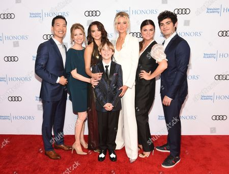 "Stock Picture of Eddie Shin, Jolie Jenkins, Paris Berelc, Finn Carr, Isabel May, Tiffani Thiessen, Emery Kelly. Eddie Shin, from left, Jolie Jenkins, Paris Berelc, Finn Carr, Isabel May, Tiffani Thiessen and Emery Kelly from ""Alexa & Katie,"" arrive at the 12th Annual Television Academy Honors, at the Beverly Wilshire Hotel in Los Angeles"