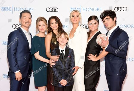 "Eddie Shin, Jolie Jenkins, Paris Berelc, Finn Carr, Isabel May, Tiffani Thiessen, Emery Kelly. Eddie Shin, from left, Jolie Jenkins, Paris Berelc, Finn Carr, Isabel May, Tiffani Thiessen and Emery Kelly from ""Alexa & Katie,"" arrive at the 12th Annual Television Academy Honors, at the Beverly Wilshire Hotel in Los Angeles"