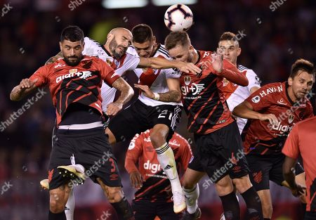 Javier Pinola of Argentina's River Plate, second from left, competes to head the ball amid Luis Gonzalez of Brazil's Athletico Paranaense, far left, and Leo Pereira of Brazil's Athletico Paranaense, fourth from left, and his River Plate teammate Lucas Martinez Quarta, during the Recopa Sudamericana final soccer match in Buenos Aires, Argentina, . River won the match and the championship