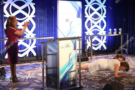 """Julie Cohen, Betsy West. Julie Cohen, Director/Producer, left, and Betsy West, Director/Producer, accept the Television Academy Honors Award for """"RBG,"""" and do planks on stage at the 12th Annual Television Academy Honors, at the Beverly Wilshire Hotel in Los Angeles"""