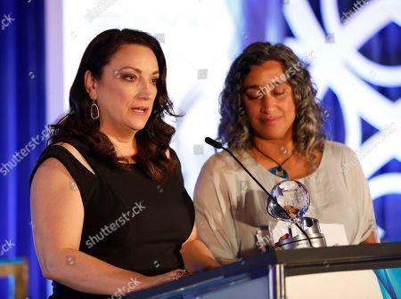 Co-directors Trish Adlesic, left, and Geeta Gandbhir accept the Television Academy Honors award for 'I Am Evidence'